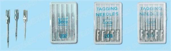 изображены три коробки с иглами плюс три иглы для игольчатого этикет-пистолета