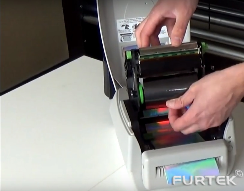 как вставляется риббон в принтер этикеток