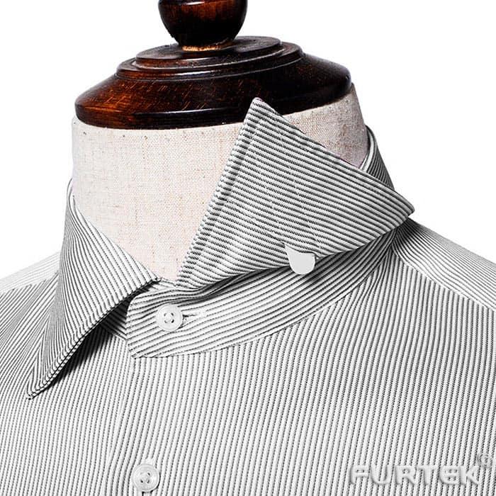 Пластмассовая косточка в воротничке рубашки