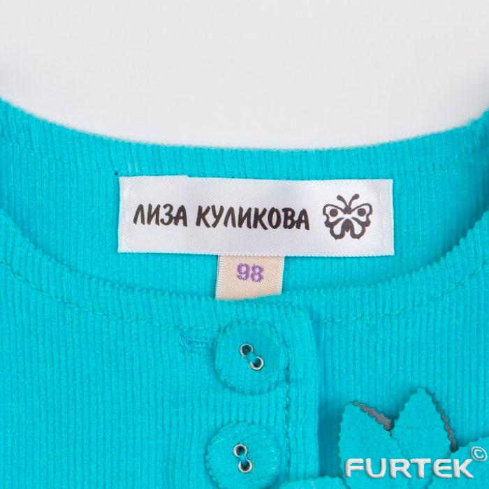 этикетка для одежды с информацией на кофточке