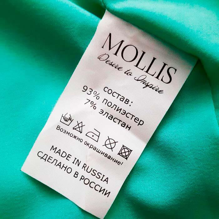 Что означает зачеркнутый треугольник на бирке одежды