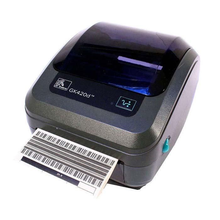Принтер для печати этикеток серого цвета с прозрачной крышкой в полуразвороте