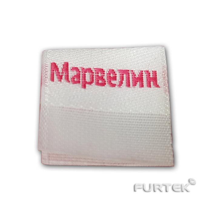 Жаккардовая белая этикетка со сгибом Марвелин фото