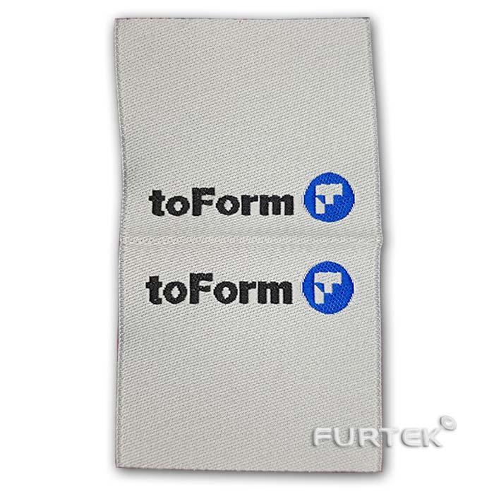 Жаккардовая белая этикетка со сгибом toForm развернутая фото