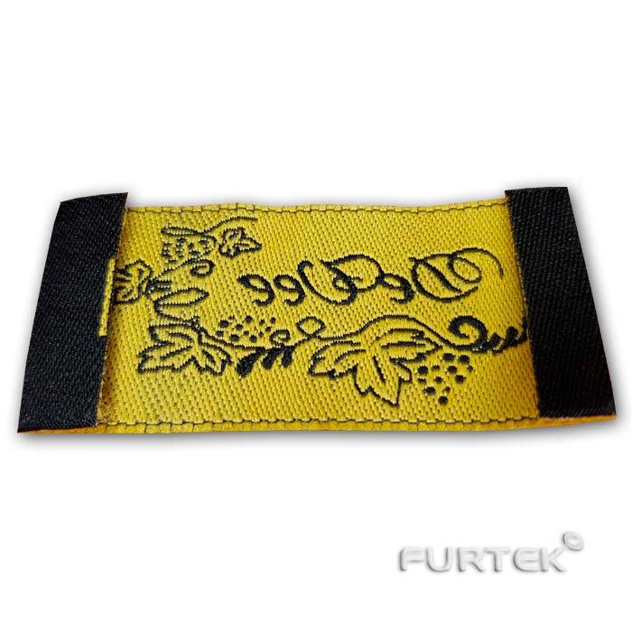Жаккардовая этикетка черная, золотой текст, вид с обратной стороны, фото